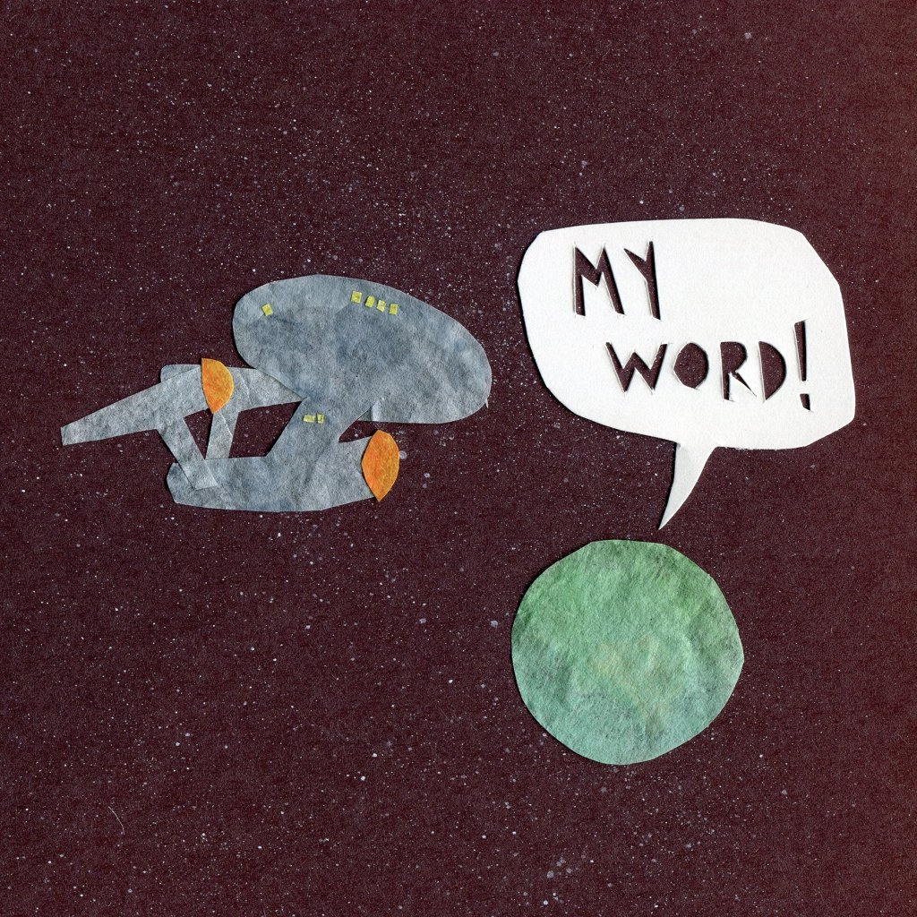 The Enterprise waits by a green planet. From the planet, a word bubble emerged :My Word!